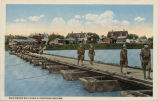Engineers building a pontoon bridge